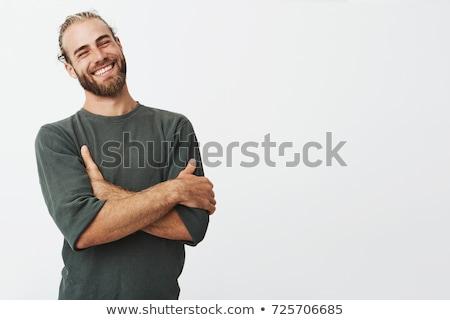 Retrato feliz jovem barbudo homem em pé Foto stock © deandrobot