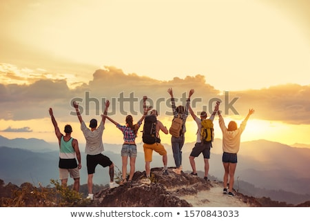 happy friends or travelers hiking with backpacks stock photo © dolgachov