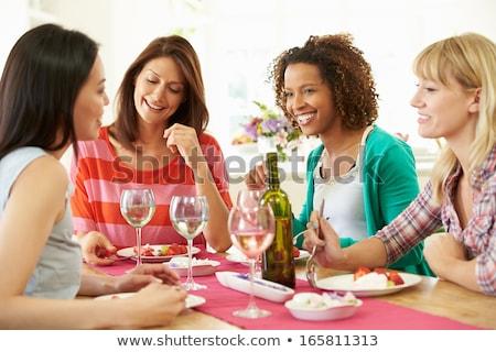 Ragazza seduta tavolo da cucina vetro vino bianco alimentare Foto d'archivio © ruslanshramko