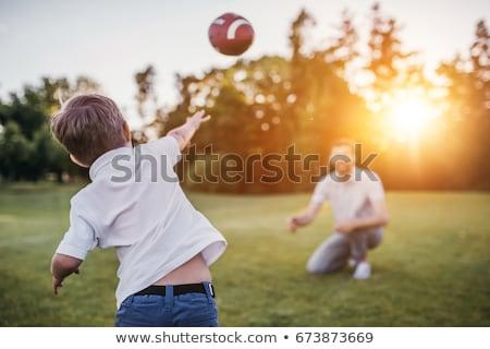 hijo · de · padre · partido · de · fútbol · familia · hierba · hombre · naturaleza - foto stock © lopolo