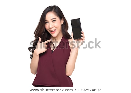 Foto d'archivio: Young Smiling Woman Pointing At Touchscreen Of Smartphone