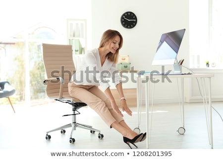businesswoman doing stretching exercise stock photo © andreypopov
