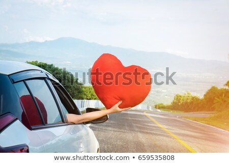 Relaxed happy traveler, Young beatiful asian gilr holding big re Stock photo © Freedomz