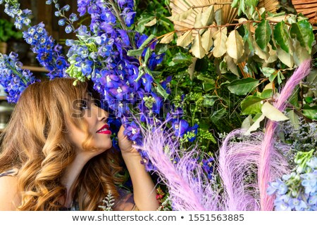 Customer smelling and admiring flowers at a florist shop Stock photo © lovleah