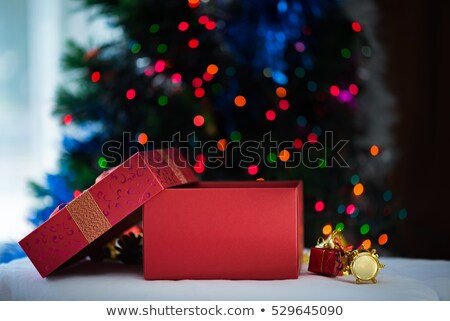 Christmas boxes tied with colored ribbons closeup Stock photo © ElenaBatkova
