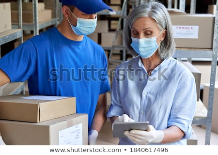 Boss and Deliverer with Cargo Delivery Service Stock photo © robuart