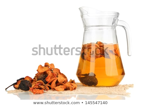 Dried fruits compote in glass on white Stock photo © joannawnuk