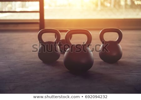 Kettlebell on the gym floor Stock photo © boggy