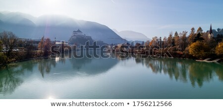 Kufstein Fortress beautiful landscape with smooth river on a forefront, Austria. Stock photo © artjazz