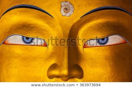 Buda yüz gözler altın heykel Stok fotoğraf © dmitry_rukhlenko