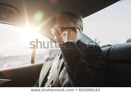 Senior Geschäftsmann fahren Auto zurück Sitz Stock foto © dolgachov