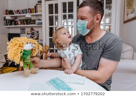 Woman in a mask holding a doll Stock photo © pdimages