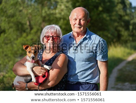 senior couple posing with their dog in a park Stock photo © photography33