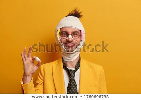 Adam bandaj siyah komik beyaz stüdyo Stok fotoğraf © pzaxe