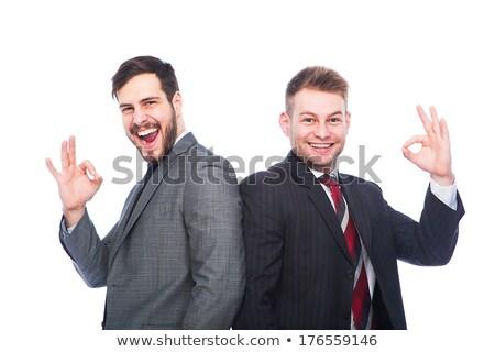 Karizmatikus üzletember mutat ok felirat fehér Stock fotó © wavebreak_media