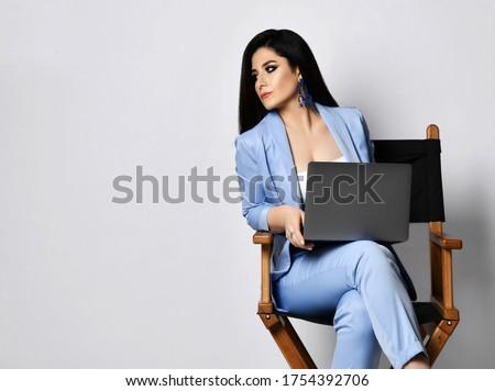 Stern businesswoman holding laptop Stock photo © photography33