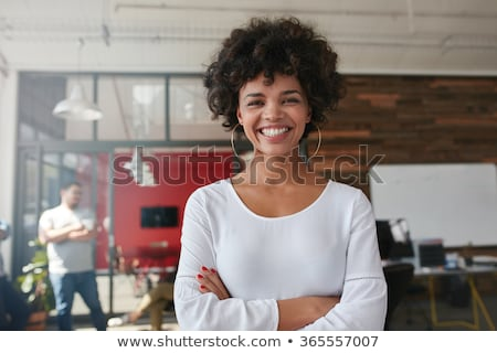 Smiling young woman with male colleagues out of focus in the background Stock photo © photography33