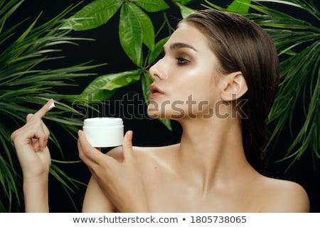 nő · fürdőköpeny · tart · bögre · krém · oldalnézet - stock fotó © chesterf