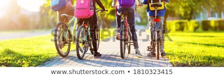 Teenagers cycling. Stock photo © Fisher