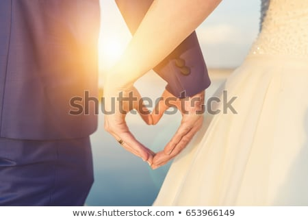 Wedding rings. Closeup of hands of bridal couple with wedding ri Stock photo © EwaStudio