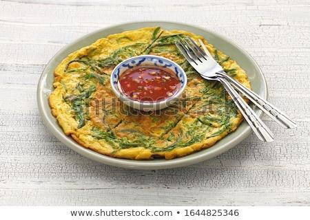 Stock photo: Thai omelet Fries egg in plate on isolate