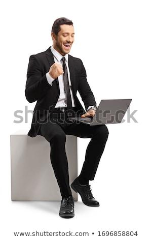 elegant business man sitting on a white cube stock photo © feedough