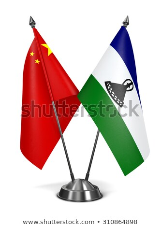 China Lesotho miniatuur vlaggen geïsoleerd witte Stockfoto © tashatuvango