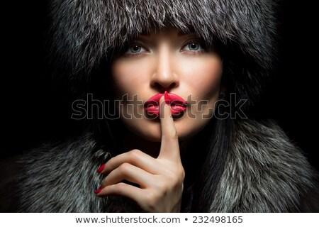 Portrait of a beautiful girl wearing white fur  Stock photo © konradbak