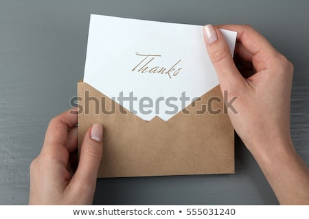 woman holding card with thank you word stock photo © fuzzbones0