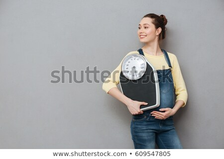 Pregnant woman is measuring and weighing Stock photo © DNF-Style
