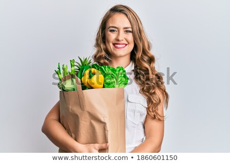 Smiling blonde with paper bags Stock photo © Paha_L