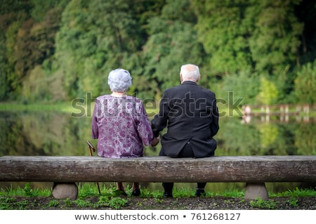 romantic married couple sitting on the beach stock photo © deandrobot