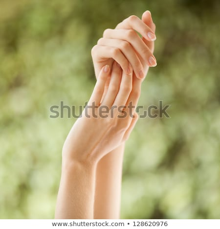 Woman hands with perfect manicure applying moisturizer cream Stock photo © Nobilior