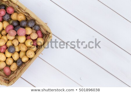 Stock photo: Wicker basket filled with assorted fresh potatoes