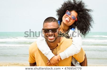 Young african-american happy traveler. Stock photo © RAStudio