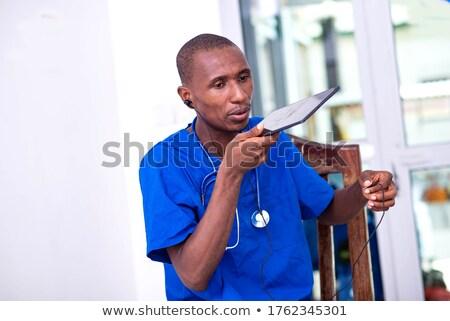 Médecin parler haut-parleur annonce médicaux Photo stock © RAStudio