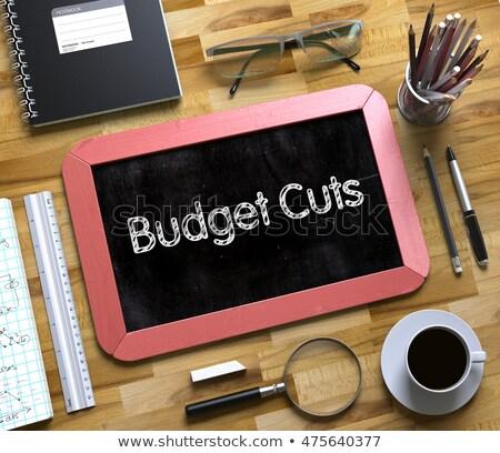 Budget Cuts Handwritten on Small Chalkboard. 3D Rendering. Stock photo © tashatuvango