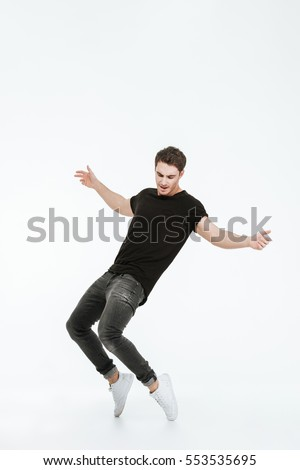 Stock photo: young man dancing over black