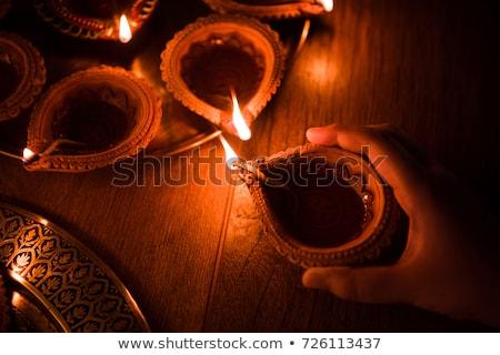 hand holding burning diya, diwali festival background Stock photo © SArts