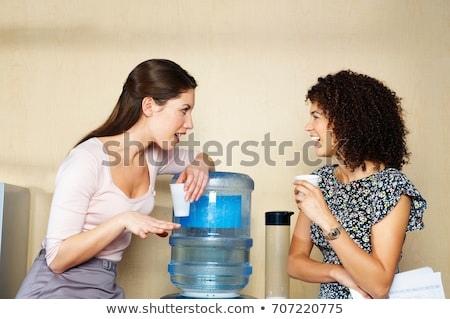 two women are chatting by water cooler stock photo © is2
