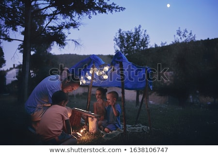 Boy playing under tent Stock photo © IS2
