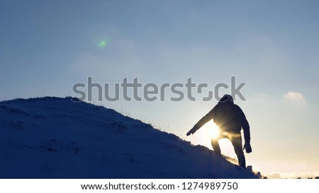 climber celebrating on snow capped peak Stock photo © IS2