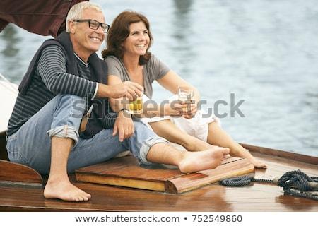 Középkorú pár iszik csónak férfi utazás Stock fotó © IS2