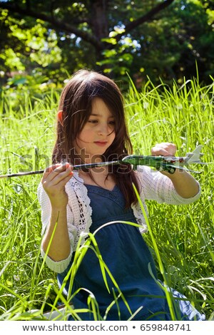Girl painting model airplane outdoors Stock photo © IS2
