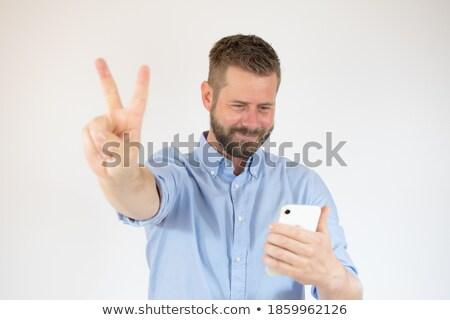 Excitado hombre victoria signo hablar Foto stock © feedough