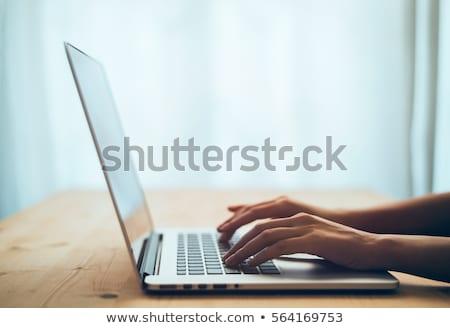 Woman Typing On Laptop Keypad Stock photo © AndreyPopov