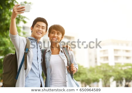 asian woman student taking selfie with smartphone stock photo © dolgachov