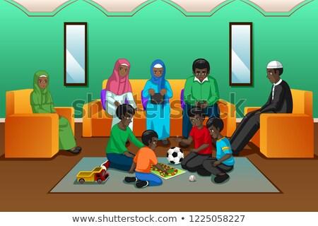 Africano muçulmano família jogar sala de estar mulher Foto stock © artisticco