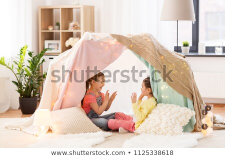 girls playing clapping game in kids tent at home Stock photo © dolgachov