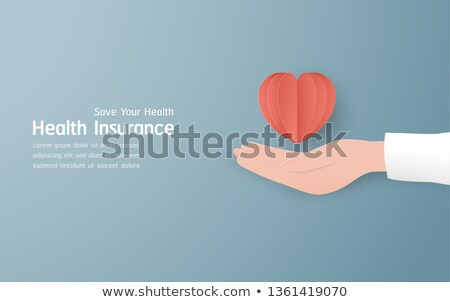 Doctor's Hand Holding Family Paper Cut Out Stock photo © AndreyPopov